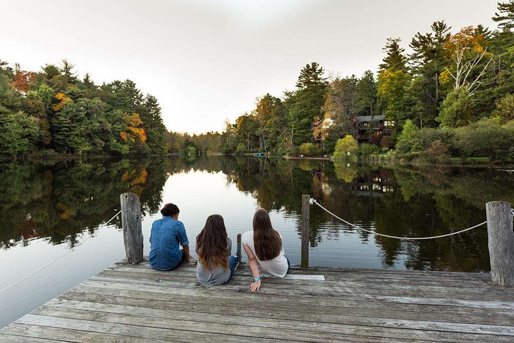 Students on pier at lake
