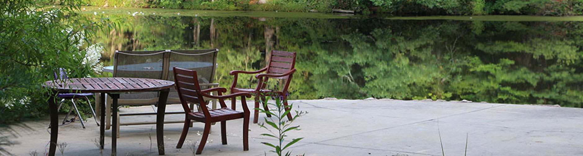 Tables and chairs on lake