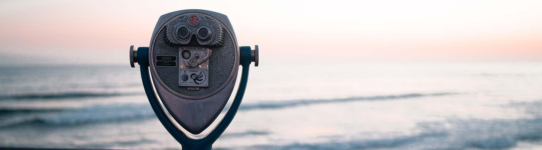 Binoculars looking to the sea